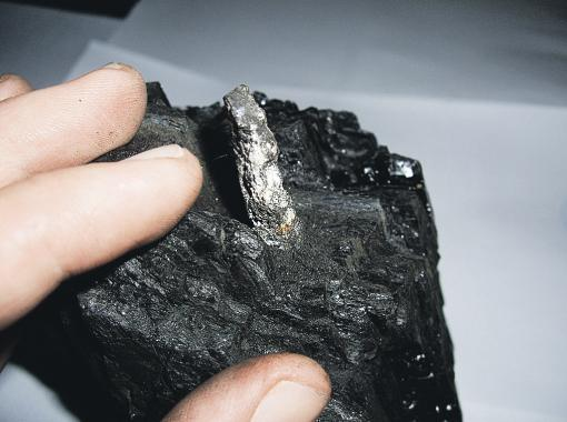 The metal shown here embedded in coal.